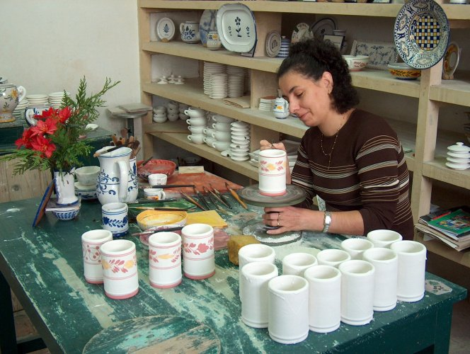 Painting the ceramic pottery